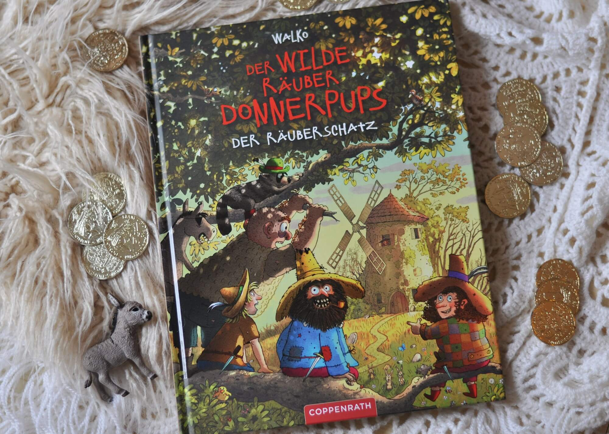 Eine Räubergeschichte von einem echten Schatz und die Freude am Teilen für Kinder ab 4 Jahren. Mit Buch im Buch. #räuber #donnerpups #lesen #vorlesen #räuberbande #bilderbuch #kinderbuch #teilen #goldschatz #schatzsuche