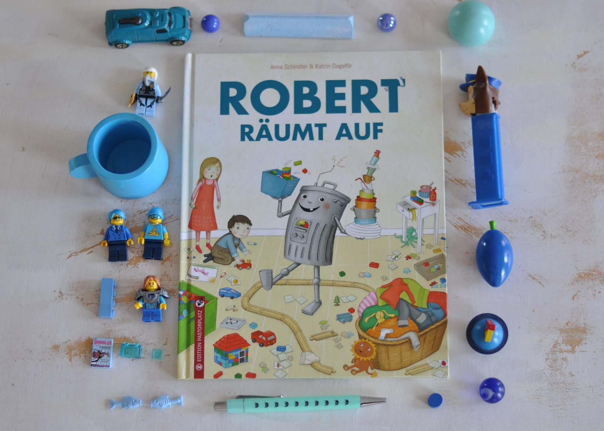 Aufräumen ist doof. Doch eines Tages steht Robert vor der Tür. Robert der Roboter, der ein bisschen wie eine Mülltonne mit Schirmchen ausschaut. Er räumt das Kinderzimmer auf, spült das Geschirr und putzt das Klo. #aufräumen #robert #roboter #ordnung #wohnung #kinder #bilder #buch #lesen
